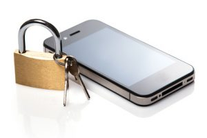 Smartphone and padlock on white background